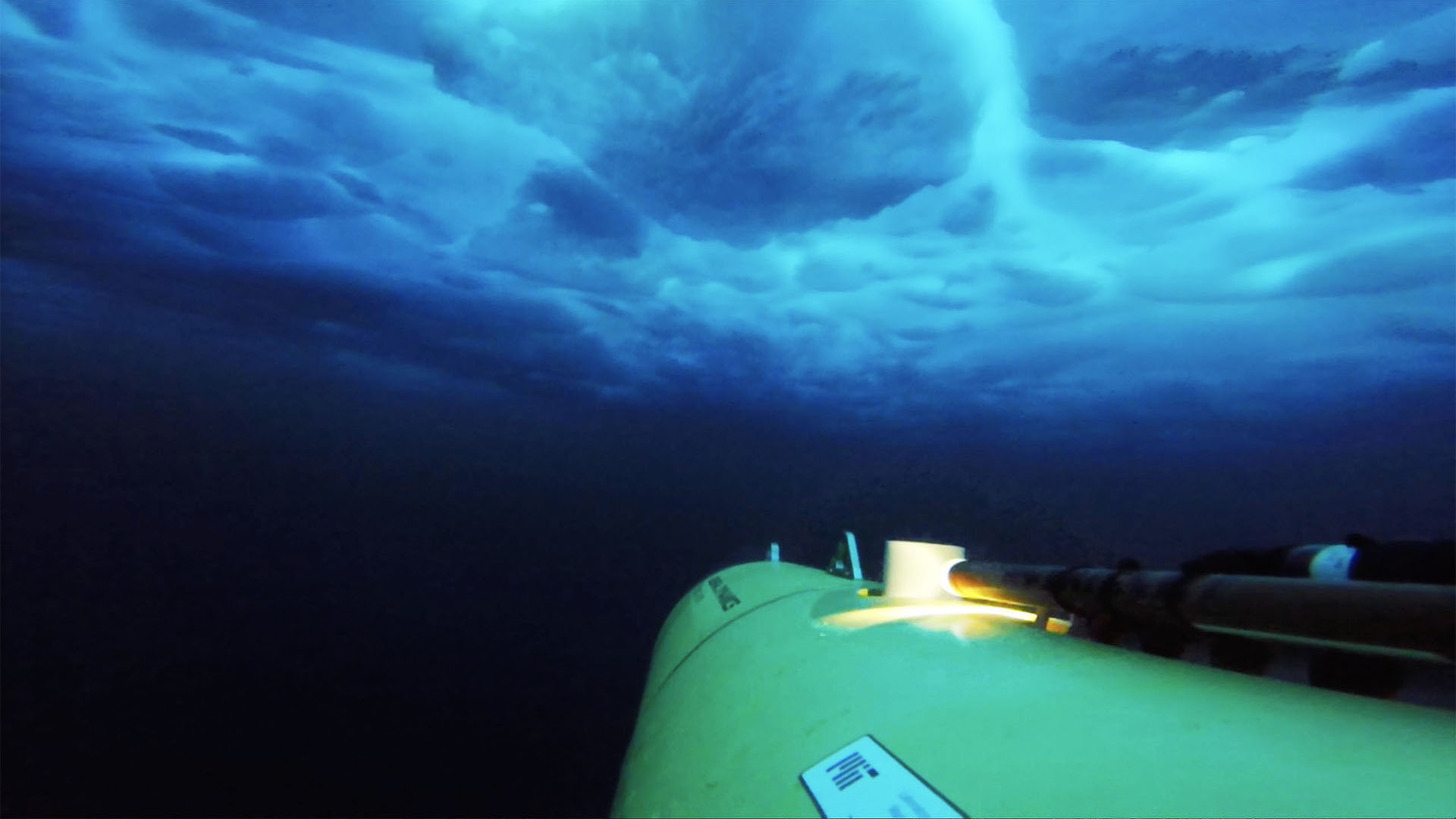 An unmanned autonomous vehicle explores the water under ice in the Arctic.