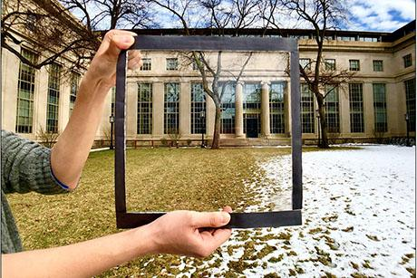 See-through film material rejects 70 percent of incoming solar heat and could be used to coat windows